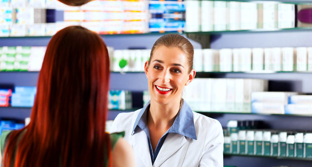 pharmacist smiling to a customer
